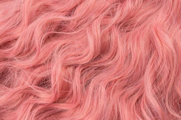 Rosa schönes welliges haarmuster. draufsicht.