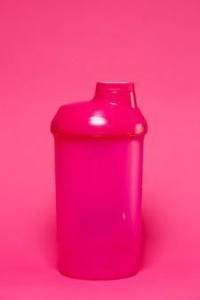 Rosa shaker, farbiger hintergrund, sport, energy drink, fitnessgeräte