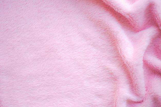 Rosa stoff baumwolle hintergrund. display abstrakte textur luxus tuch weiche welle. für gute verwendung von text präsentieren oder fördern sie ihre waren, produkte auf freiraumhintergrund. ansicht von oben oder flach.