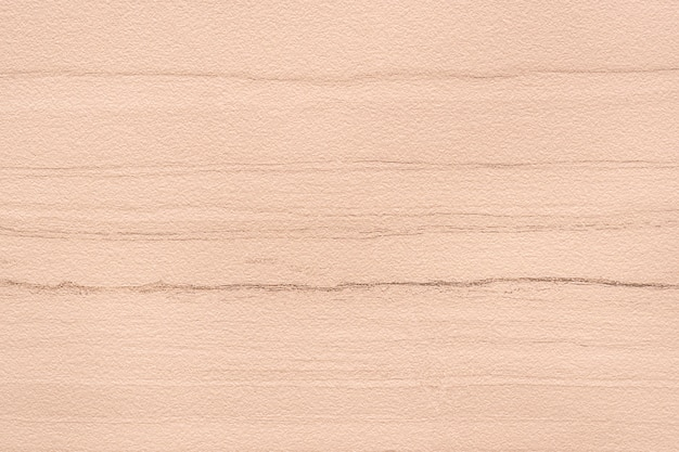 Rosa strukturierter hintergrund der betonmauer