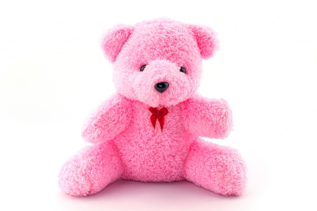 Rosa teddybärpuppe auf weißem hintergrund