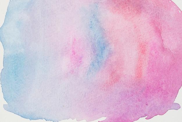 Rosa- und aquamarinemischung von farben auf weißem papier