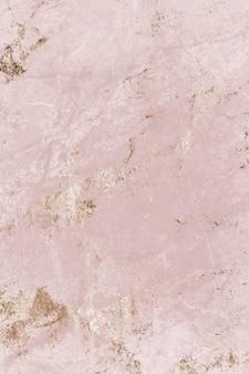 Rosa und goldener marmor strukturierter hintergrund