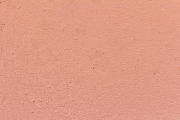 Rosa und orange beschaffenheitshintergrund der wandfarbe