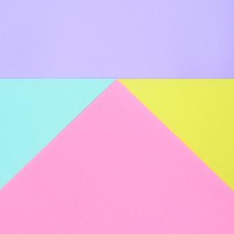 Rosa, violettes, gelbes und blaues geometrisches papier