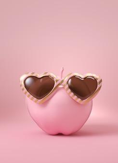 Rosafarbener apfel mit gold und rosafarbener sonnenbrille