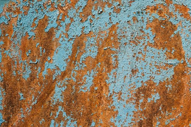 Rostiges metall türkis und rote farbe textur hintergrund oxidierte metalloberfläche alte vintage lackiert
