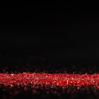 Rot schimmernder glitzer mit kopierraum