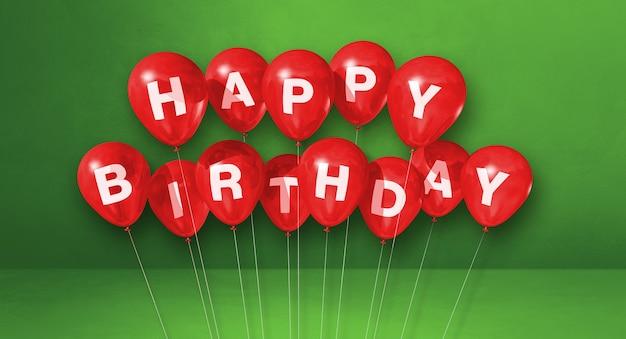 Rote alles gute zum geburtstagluftballons auf einer grünen szene. 3d-darstellung rendern