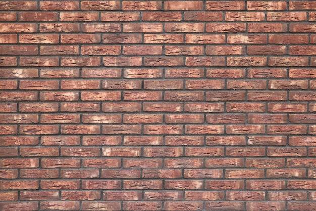 Rote backsteinmauer mit strukturierter oberfläche