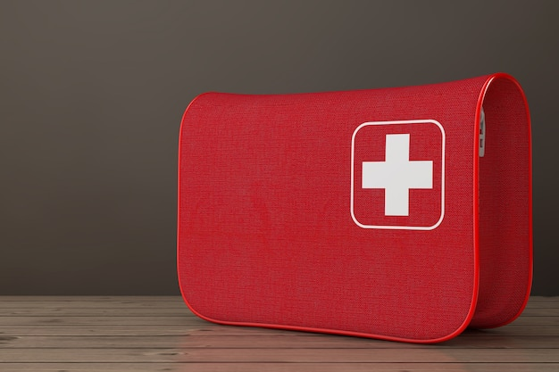 Rote erste-hilfe-set-weiche tasche mit weißem kreuz auf einem holztisch. 3d-rendering