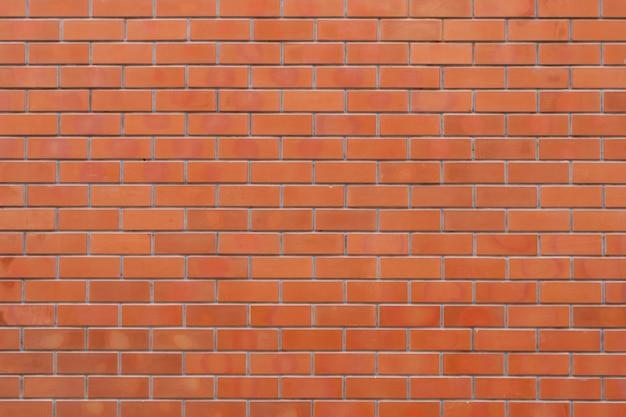 Rote farbe backsteinmauer für mauerwerk hintergrund und textur.
