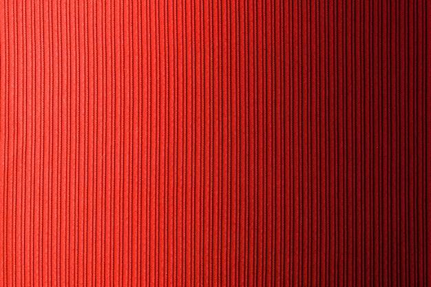 Rote farbe des dekorativen hintergrundes, horizontale steigung der gestreiften beschaffenheit. tapete. kunst. design.