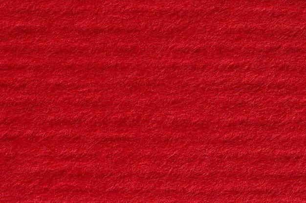 Rote handgeschöpfte papierstruktur. hochauflösendes foto.