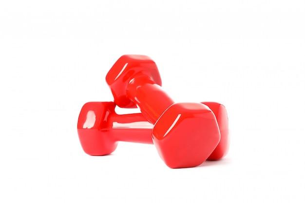 Rote hanteln für fitness lokalisiert auf weiß