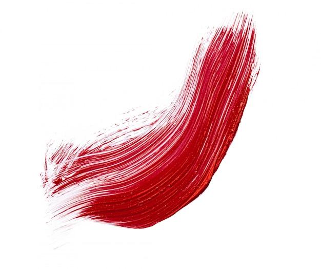 Rote lippenstiftfleckflecken lokalisiert auf weiß