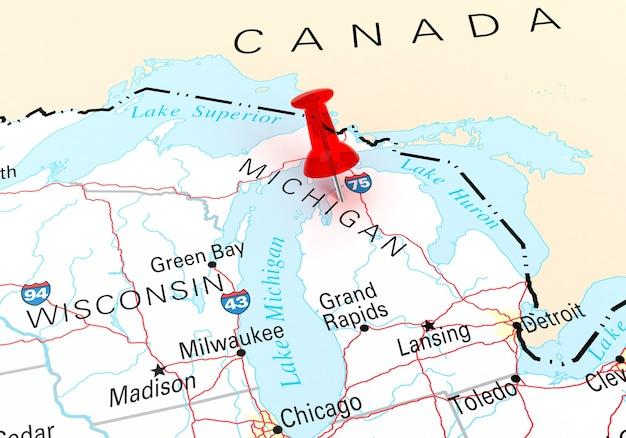 Rote reißzwecke über michigan state usa karte. 3d-rendering