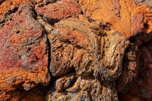 Rote rostige farbbeschaffenheit des lanzarote-lavasteins