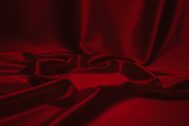 Rote seide oder satin luxus stoff textur kann als abstrakt verwenden.