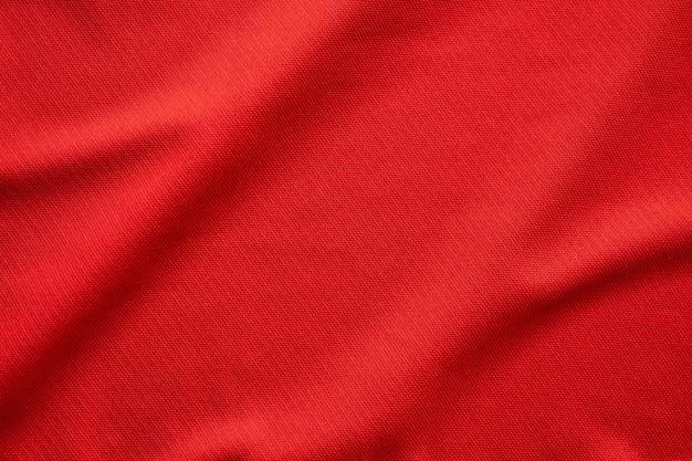Rote sportbekleidung stoff fußball trikot textur nahaufnahme Premium Fotos