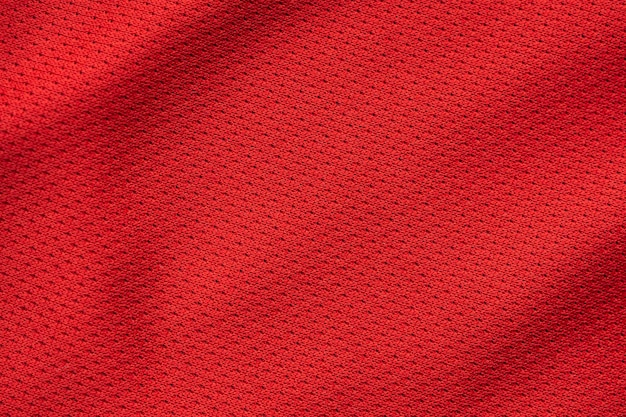 Rote sportbekleidung stoff fußball trikot textur nahaufnahme