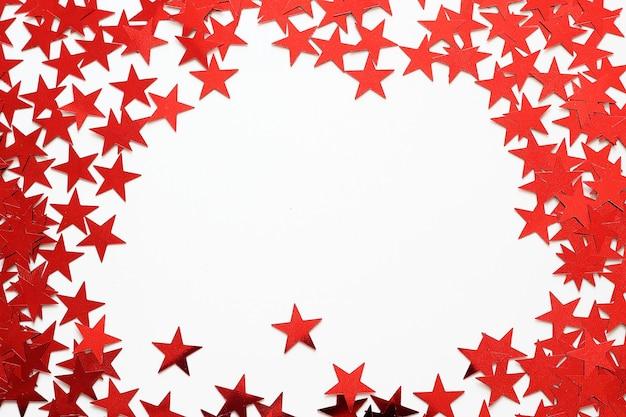 Rote sterne konfetti rahmen hintergrund