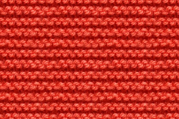 Rote strickstoff-textur. stricken textur makro schnappschuss. gestrickt