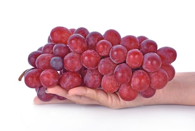 Rote trauben getrennt auf weißem hintergrund