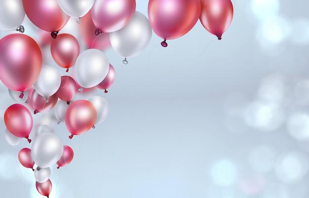 Rote und weiße ballons auf leicht unscharfem hintergrund