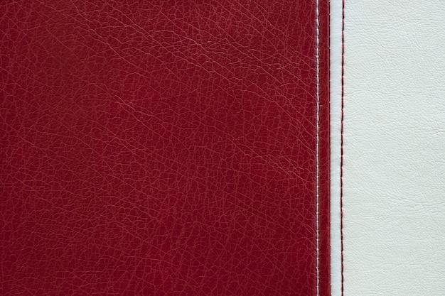 Rote und weiße lederstruktur mit einer naht