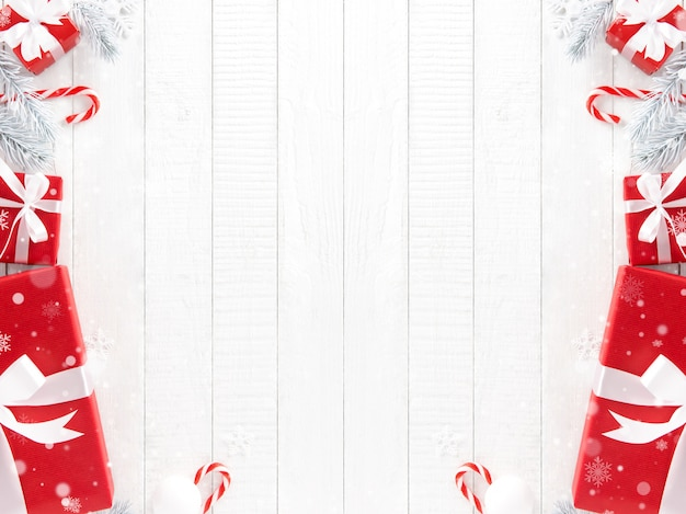 Rote weihnachtsgeschenkboxen mit verzierenden einzelteilen auf weißem täfelungshintergrund