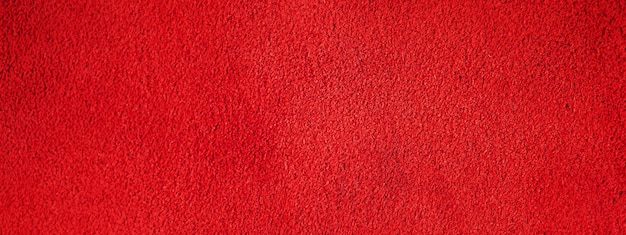 Rote wildlederstruktur. makrofoto einer roten samtbeschaffenheit.