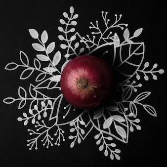 Rote zwiebel über umriss blumenhand gezeichnet