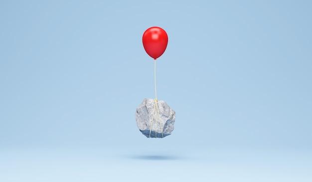 Roter ballon mit einem schweren stein auf blauem studiohintergrund