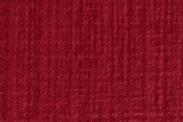 Roter bucheinbandhintergrund mit vignette. hochauflösendes foto.