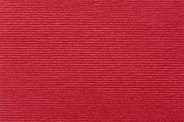 Roter bucheinbandhintergrund mit vignette. hochwertige textur in extrem hoher auflösung