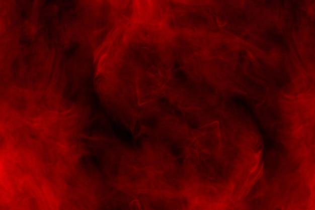 Roter dampf auf schwarzem hintergrund. platz kopieren.