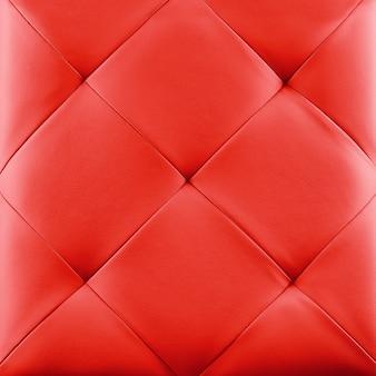 Roter echter lederpolsterhintergrund. luxusmuster.
