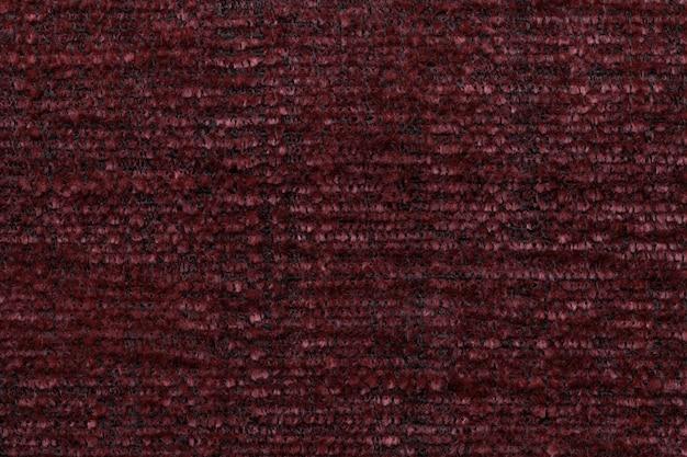 Roter flaumiger hintergrund des weichen, flaumigen stoffes, beschaffenheit des gewebes