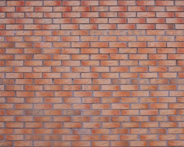 Roter gebrannter backsteinmauerhintergrund