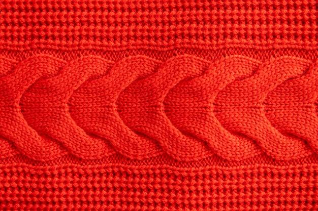 Roter gestrickter winterpullover hintergrund, rote textur
