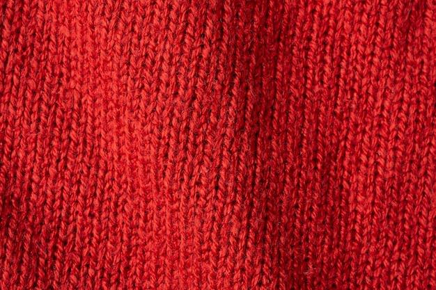 Roter gestrickter wolltexturhintergrund