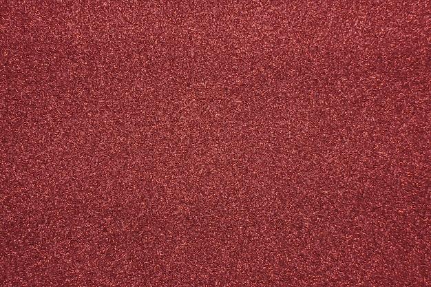 Roter glitzerhintergrund für weihnachten und mehr