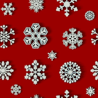 Roter hintergrund der weißen schneeflocke des weihnachtsmusters
