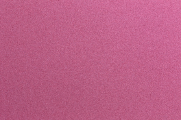 Roter kunstdruckpapierhintergrund.