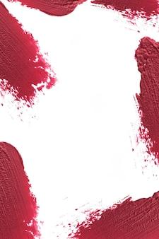 Roter lippenstift auf rand mit leerem raum in der mitte