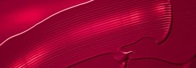 Roter lippenstift oder lipgloss-textur als kosmetisches hintergrund-make-up und schönheitskosmetikprodukt für lux...