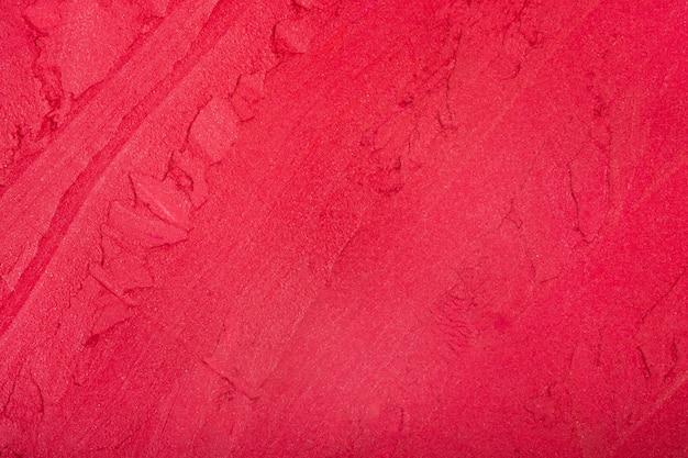 Roter lippenstiftraum. rote lippenstiftbeschaffenheit