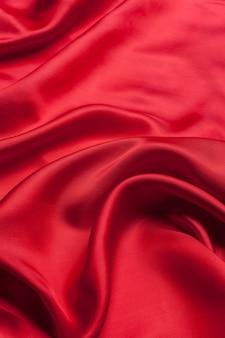 Roter stoff bewegt hintergrundbeschaffenheit wellenartig