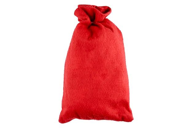 Roter stoffweihnachtssack auf isoliertem raum